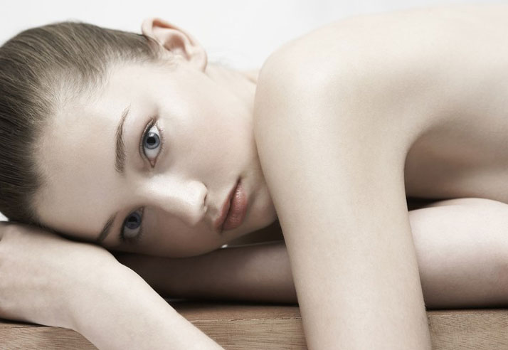 Inspiration Friday image of a girl model laying on her side.