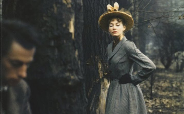 Norman Parkinson Photo of a woman with a 1900 hat and the profile of a man in the forest with earth tones for inspiration friday