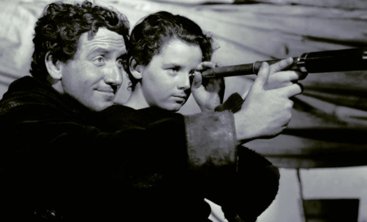 holding a telescope up in a black and white photo of Spencer Tracy in the 1937 classic Captains Courageous