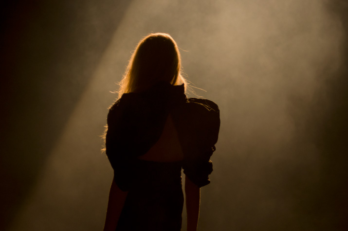 The Backlit silhouette Model in a black dress with large shoulders in A Degree Fahrenheit Spring 2012 Collection in Tokyo Fashion Week