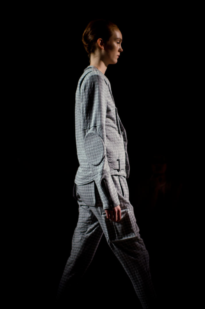 Photograph by Fashion Artist Danny Roberts of a Beautiful silhouette of Fashion model in a grey checked jumpsuit