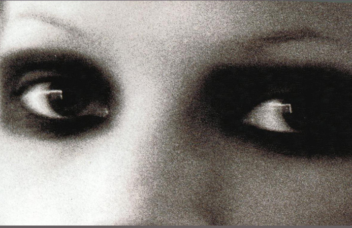 A black and white Grainy Close up Model Kate Moss smokey eyes by Fashion Photographer Steven Klein