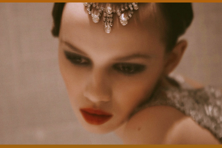 Pretty inspiration friday image of a model with jewels on her hear and bright red lips