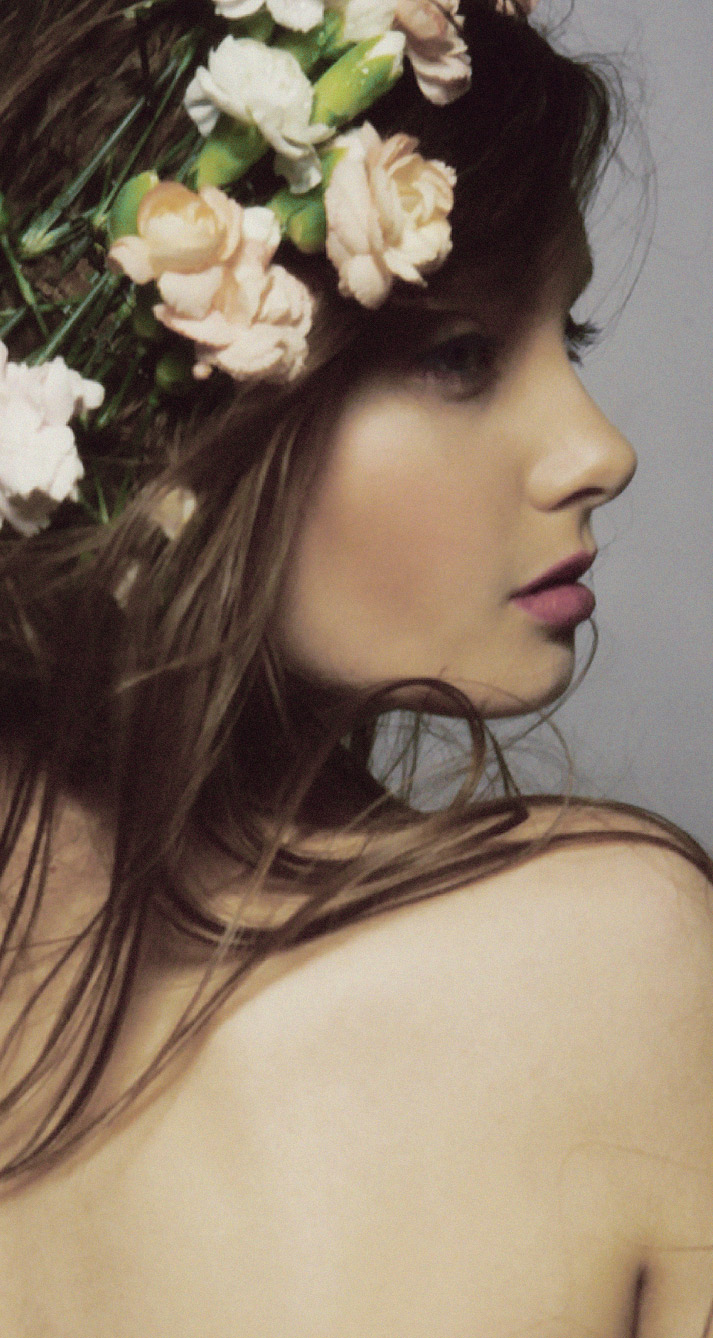 Beautiful inspiration friday photo of a girls back and profile with flowers in her hair