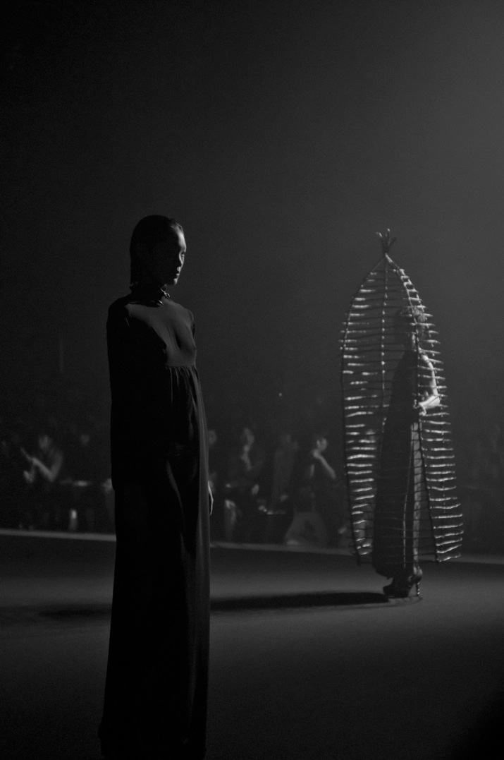 Picture by Fashion Photographer Danny Roberts of a model in a dress and a model in life size bird cage from the Christian Dada Spring 2012 show during Tokyo Fashion Week